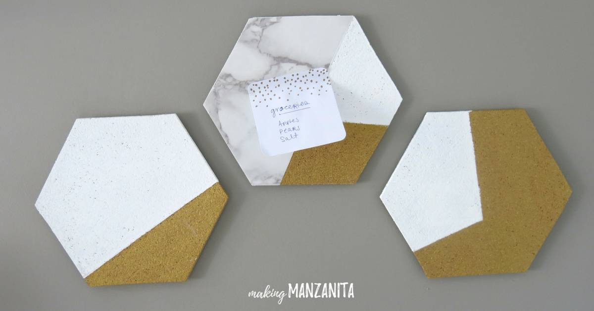 Three DIY hexagon cork boards on the wall in office being used a small wall mounted memo boards