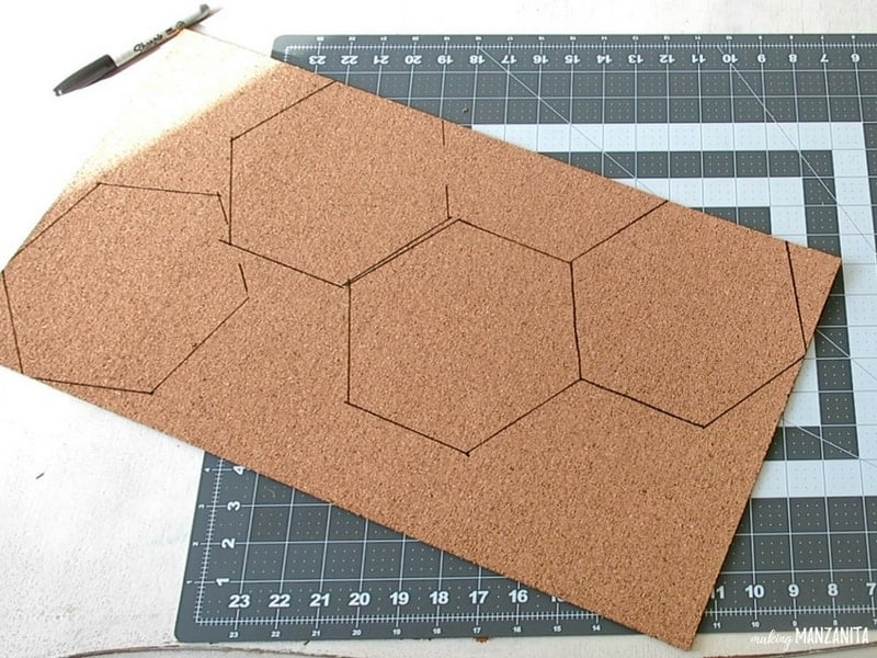 Cork board with hexagon drawings on top of the cutting mat