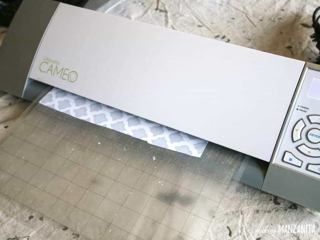 Cutting out stencils on Cameo for leather sign with pallet wood