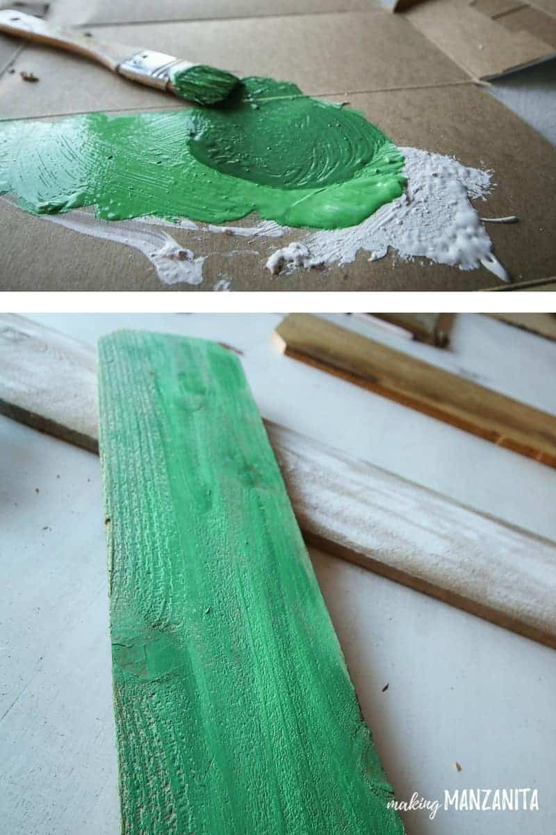 Paint an old fence board green to create a Frankenstein for cheap Halloween porch decorations. I love this simple DIY project as a cheap way to decorate for Halloween!