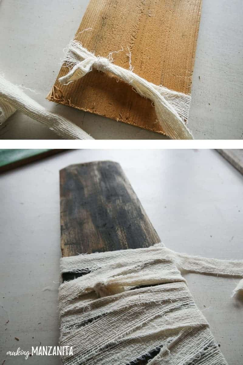 Wrap ripped fabric around an old fence board to create a mummy Halloween decoration.