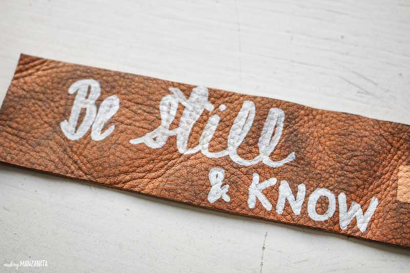 shows a leather bookmark that says be still and know
