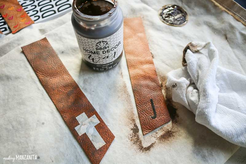 Using dark furniture wax to stain leather bookmarks