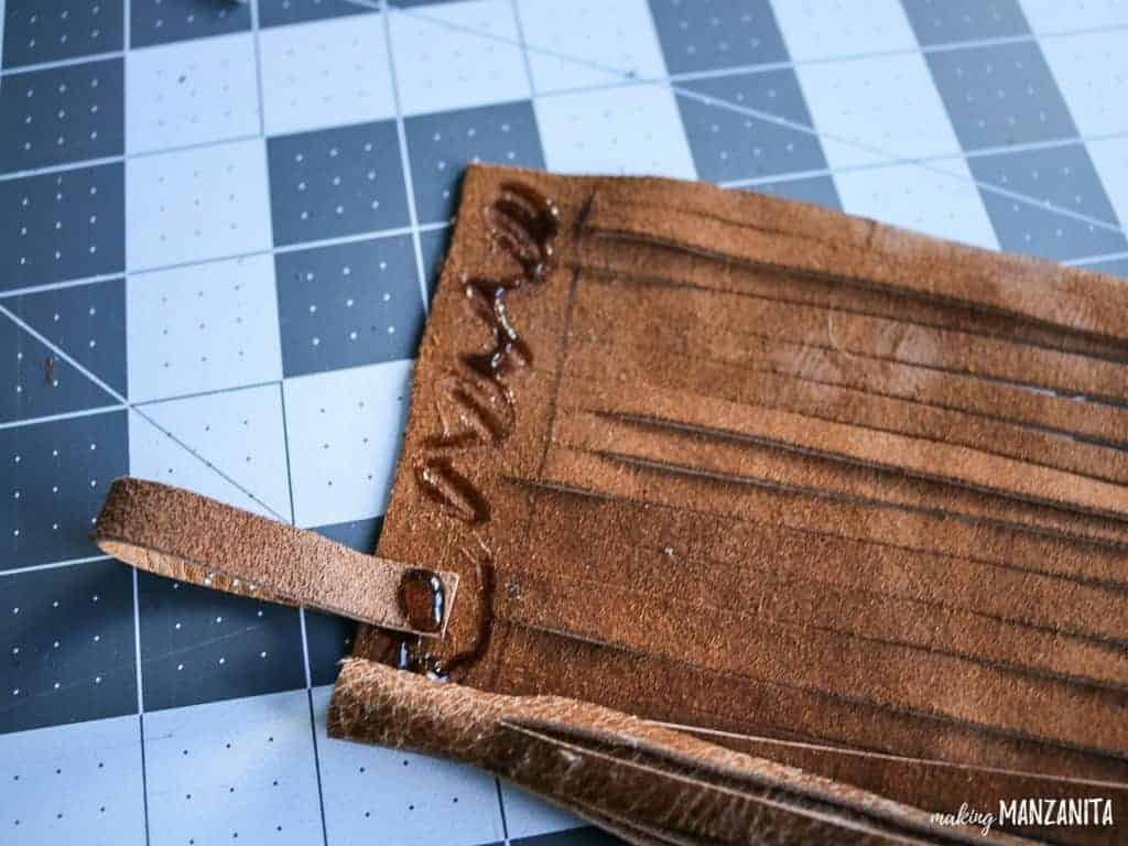 Roll up leather to make a leather tassel keychain