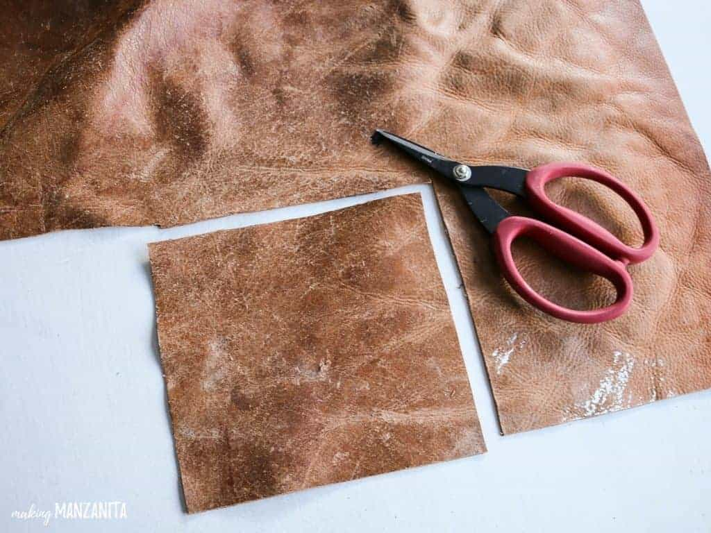 Cut a square from the leather scrap with scissors