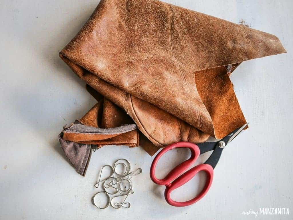 Leather scrap, scissors and chains - materials for diy leather keychains