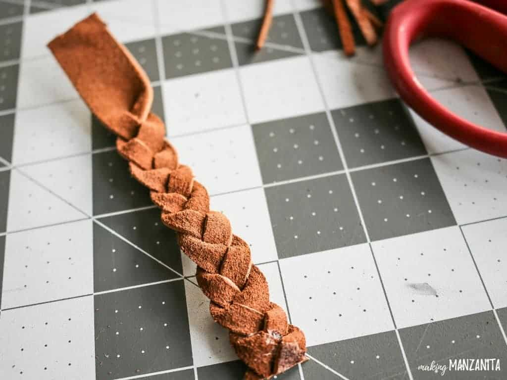 Braided leather strip cut at the tip with glue