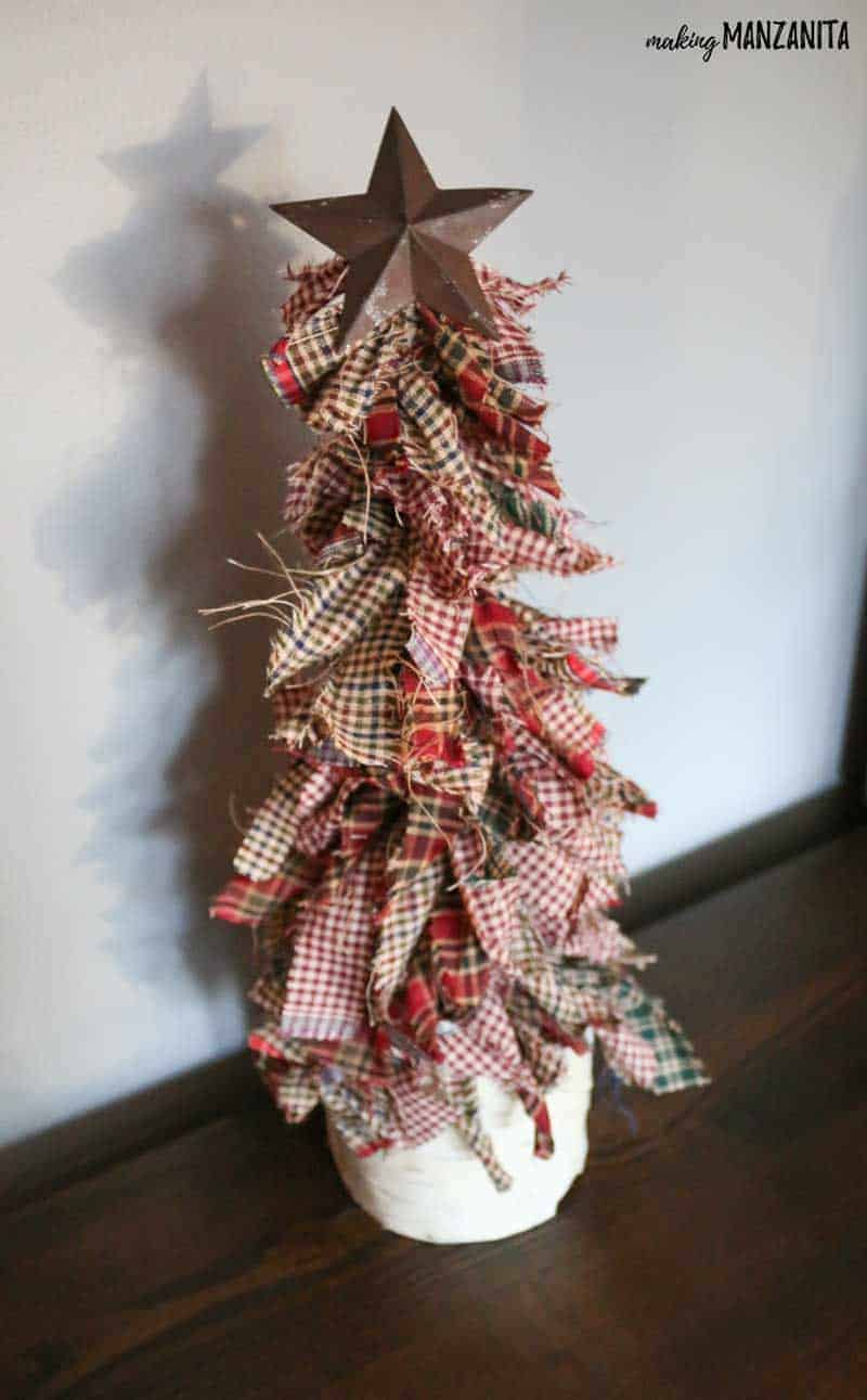 Learn how to make these primitive mini Christmas trees with homespun fabric, wooden dowel, metal star and birch wood pillar stand. Fits right in with rustic country Xmas decorations. Holiday craft ideas that kids can make. Easy crafts for the holidays. Simple Christmas gifts. Country Farmhouse Christmas style inspiration.