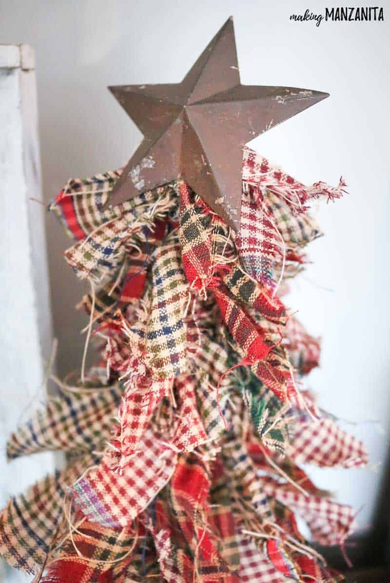 This rustic metal star is the perfect topper for this primitive mini Christmas tree! This is such an easy DIY Christmas craft that even the kids can make them!