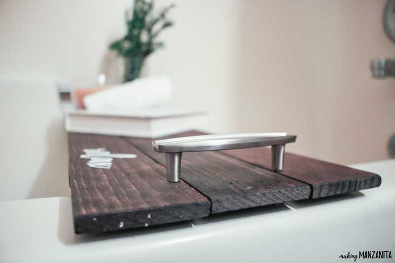 Close up shot of handles on bath tray