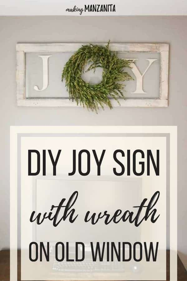 If you're looking for an easy to make Christmas DIY, you're in luck. This simple DIY joy sign with wreath on vintage window couldn't be more simple! Learn how to make this simple farmhouse Xmas sign to decorate your home for the Holidays. Such cute letters on window.