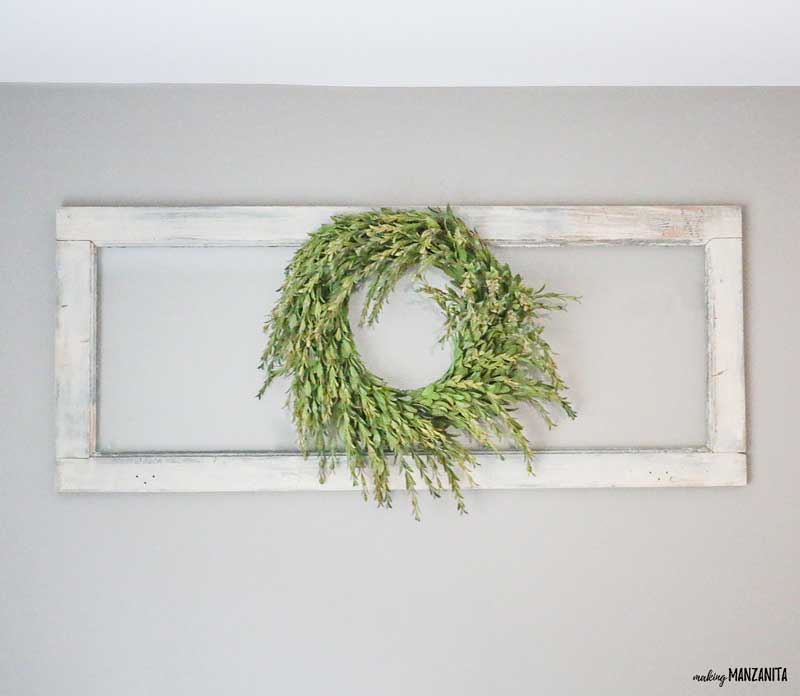 Everyone needs a little touch of greenery in their farm house style home! This easy DIY farmhouse style wreath is so simple to create to decorate in the beautiful farmhouse style. | Fixer Upper Style Greenery | Bring out your inner Joanna Gaines | How to make your own wreath | Farmhouse tutorials | Box wood | Tea leaf