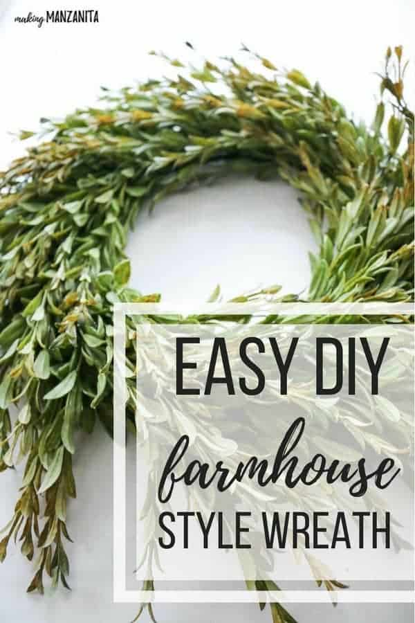 Farmhouse wreath laying on a white table with text overlay that says easy DIY farmhouse style wreath
