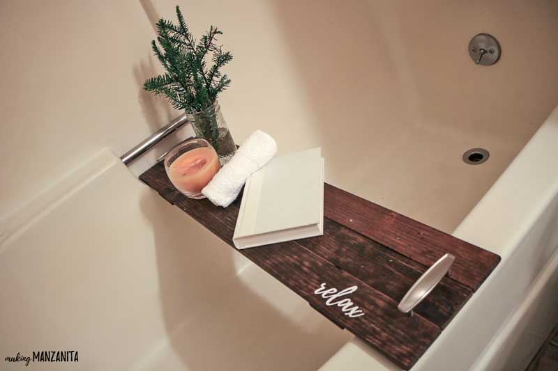 Wooden bath tub tray sitting in tub