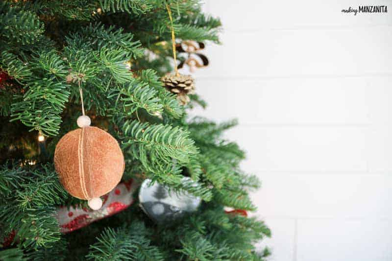 These easy leather Christmas ornaments couldn't be more simple. See how scrap recycled leather turns into super cute modern farmhouse Christmas ornaments to decorate your tree or give as Christmas gifts to your friends and family.