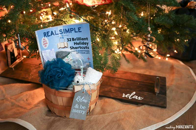 Relaxation gift basket with gift tag under the Christmas tree paired with DIY bathtub tray