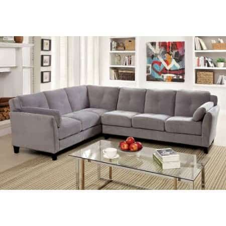 Gray couch with clean lines and velvet fabric