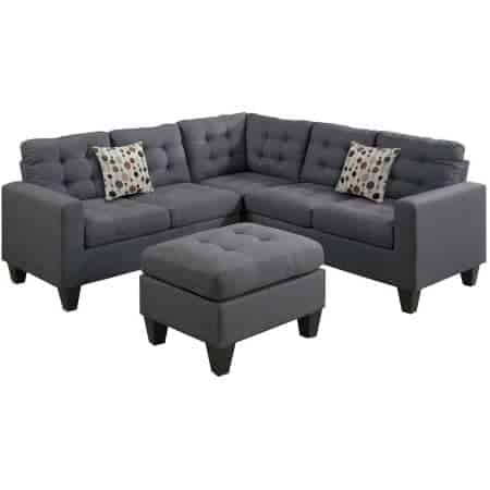 Dark grey sectional with tufted seats and back with ottoman