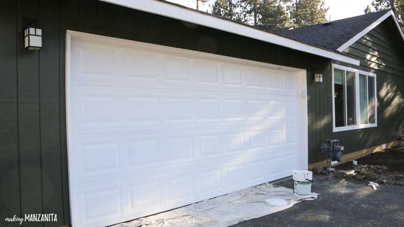 Painting garage door tutorial | 9 tips for refreshing garage door paint color | White garage door and trim, dark green exterior paint