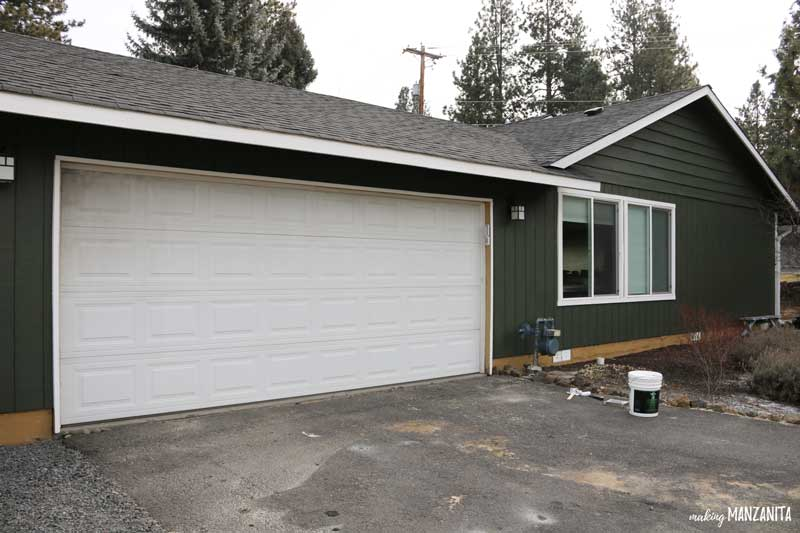 Get rid of your old grimy garage door by painting - Easy way to improve your curb appeal
