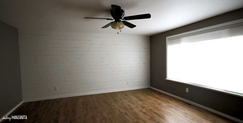 angled shot showing a room with a finished shiplap wall
