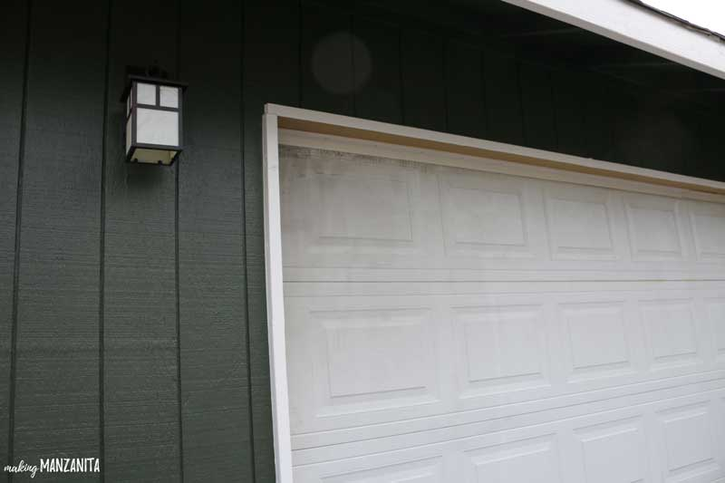 Fix old dirty garage door by painting