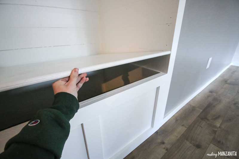 Seat that lifts up on DIY storage bench in farmhouse style reading nook with soft close hardware