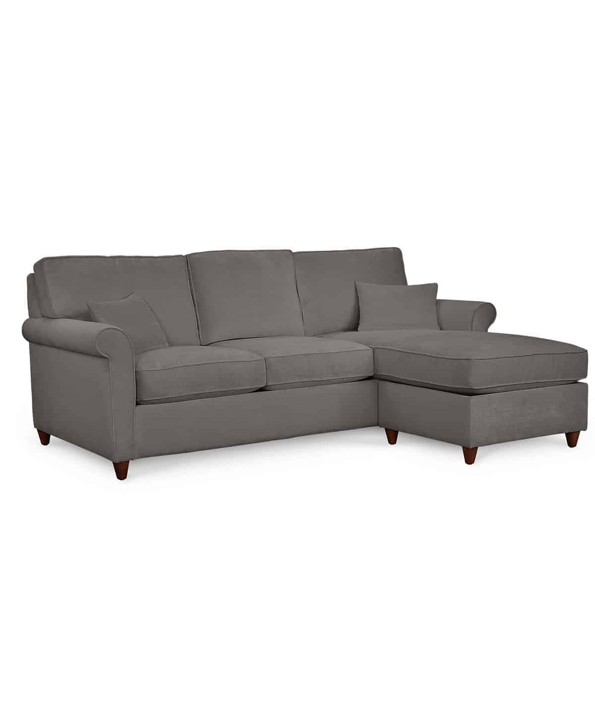 grey sectional sofa with rolled arms and an ottoman