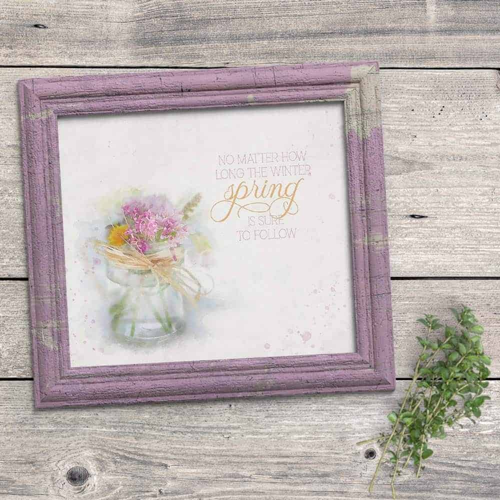 No matter how long the winter, spring is sure to follow print with farmhouse mason jar with flowers in it. The print is in a distressed purple frame on wood background