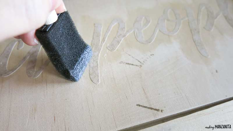 Prevent bleeding under stencils with Mod Podge when painting farmhouse signs