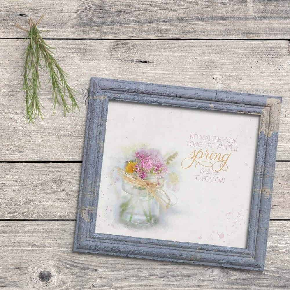 Framed spring printable with the quote no matter how long the winter, spring is sure to follow in a blue distressed frame on a wood background.