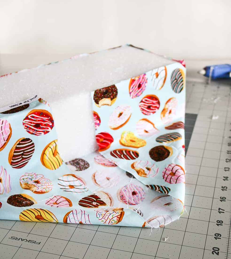 Foam block wrapped in a fabric with different donut designs.