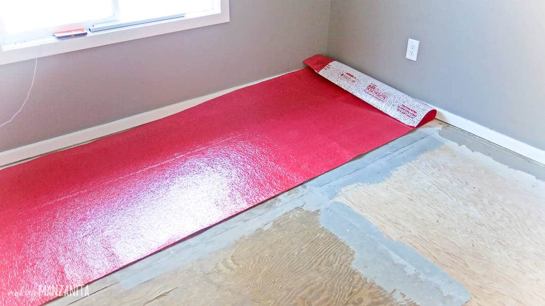Red underlayment added underneath laminate hardwood flooring
