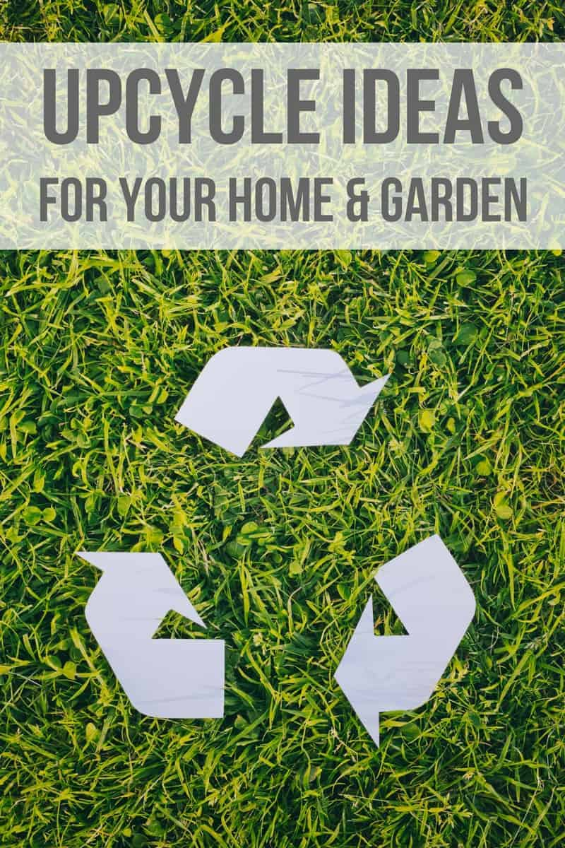 Grass with recycling symbol cut out with white paper and laid on the grass - text overlay at the top of the image that says upcycle ideas for your home and garden