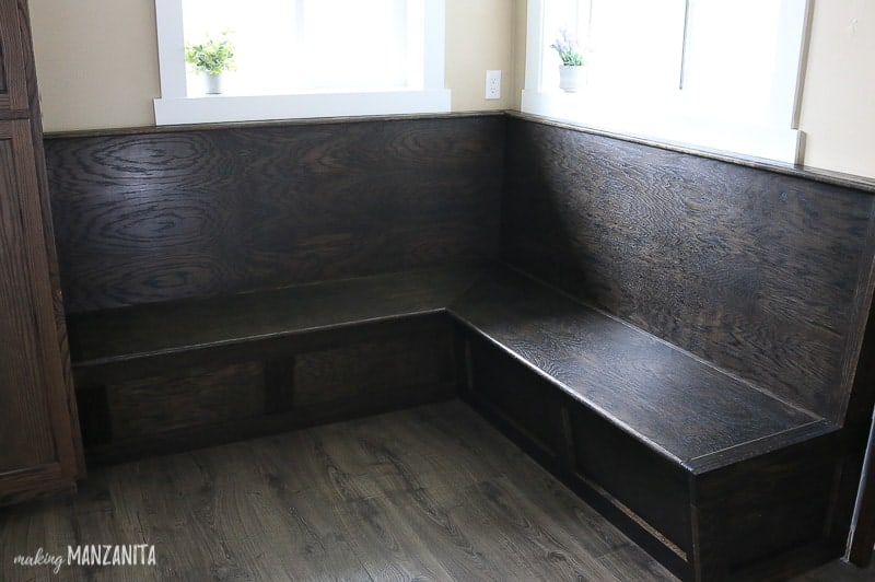 Shows a dark wood seating area with wood floors