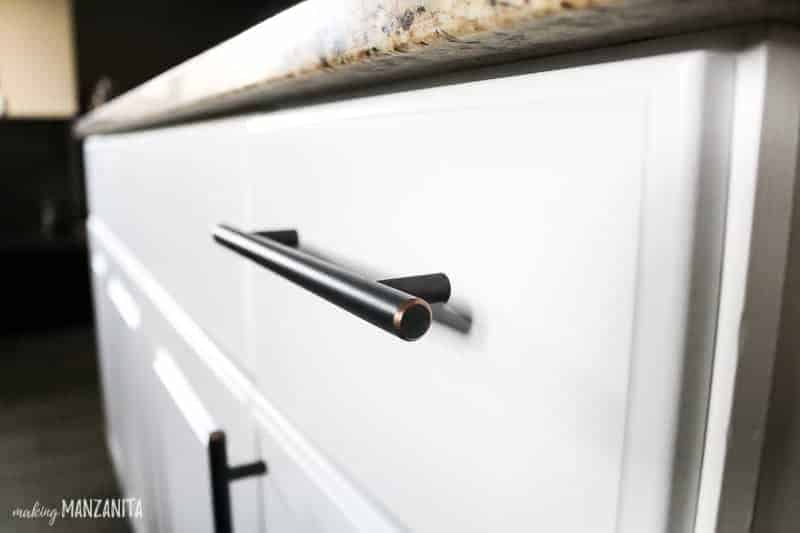 Close up angle of white kitchen drawer with modern farmhouse cabinet pulls