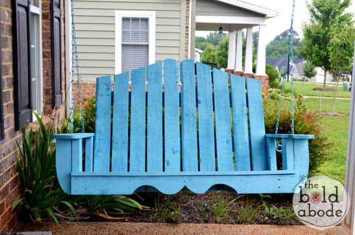 Pallet wood made into a swinging bench and painted blue