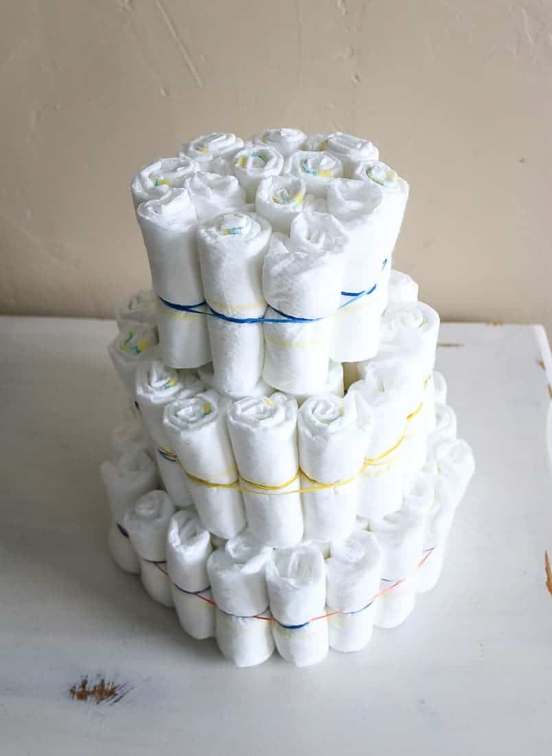 Cake looking structure made from rolled up diapers tied together with rubber bands