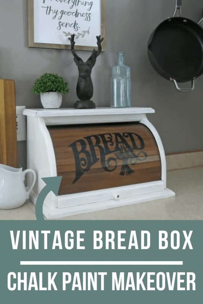 Image of a vintage bread box chalk paint makeover with tiny plant, deer figurine and old bottles above it on the kitchen countertop with text overlay that says Vintage Bread Box Chalk Paint Makeover.