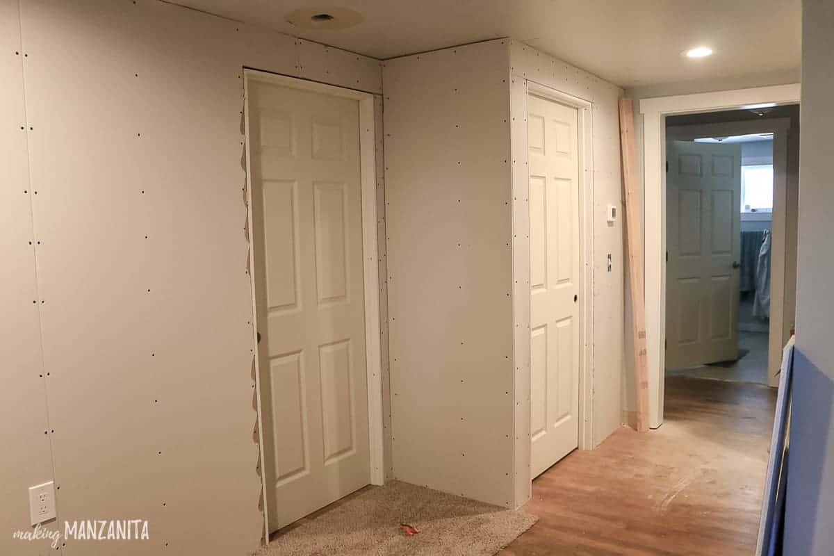 Two door ways with drywall up on the walls nearby showing an in progress renovation