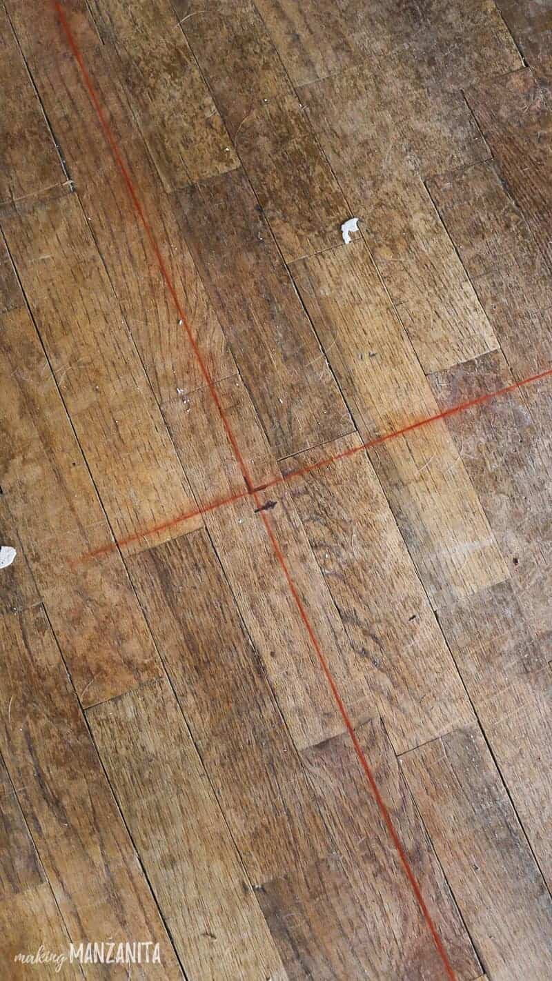 Red chalk lines on floor indicating where new wall will be built