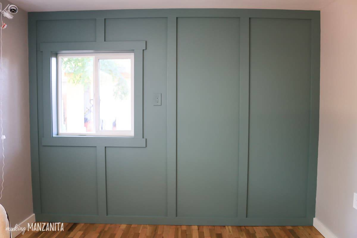 Floor to ceiling board and batten wall treatment with window painted blue green In the Moment by Behr