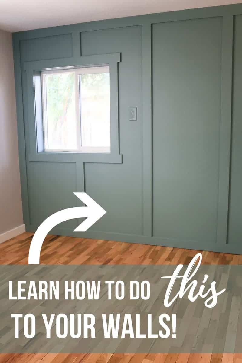 Blue green floor to ceiling board and batten wall with window and text overlay that says learn how to do this to your walls with an arrow point to wall