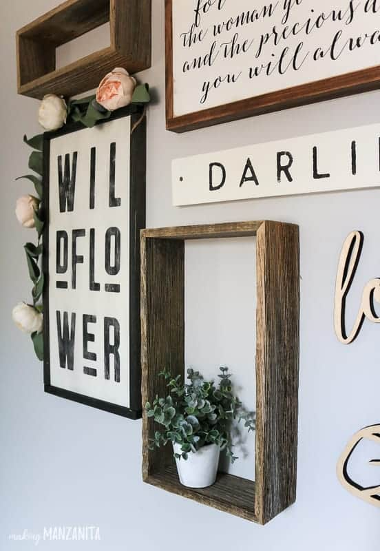 Boho style gallery wall decor in girl's nursery