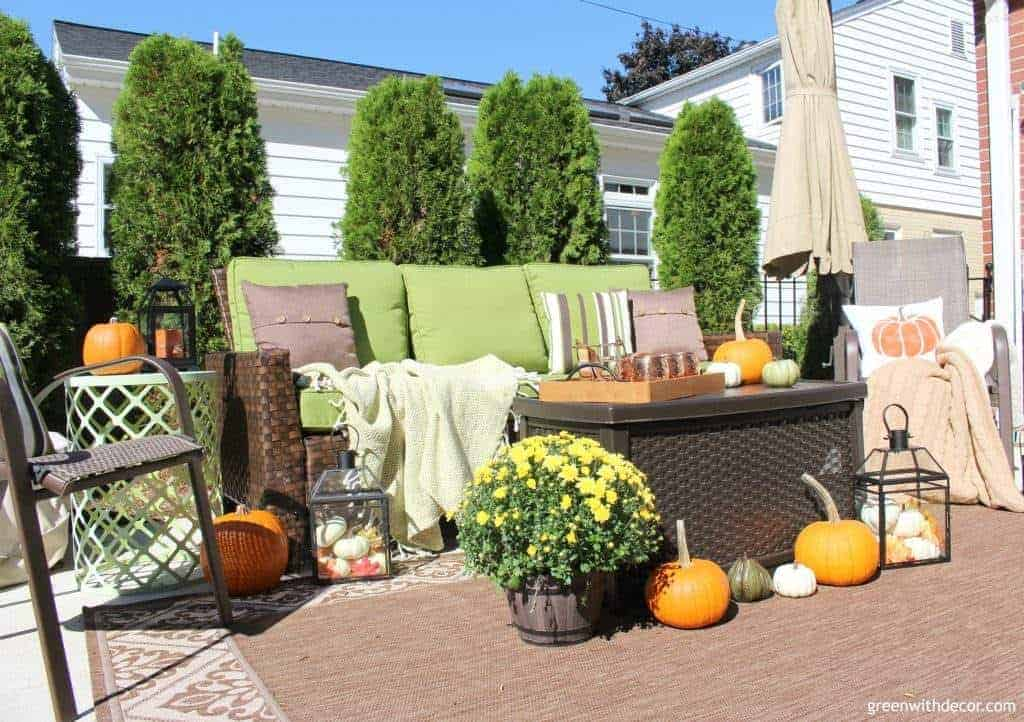 Fall outdoor patio ideas with green furniture and pumpkins - Green With Decor