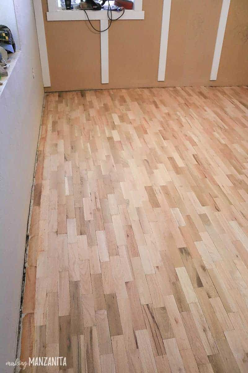 Refinished hardwood flooring in baby girl nursery