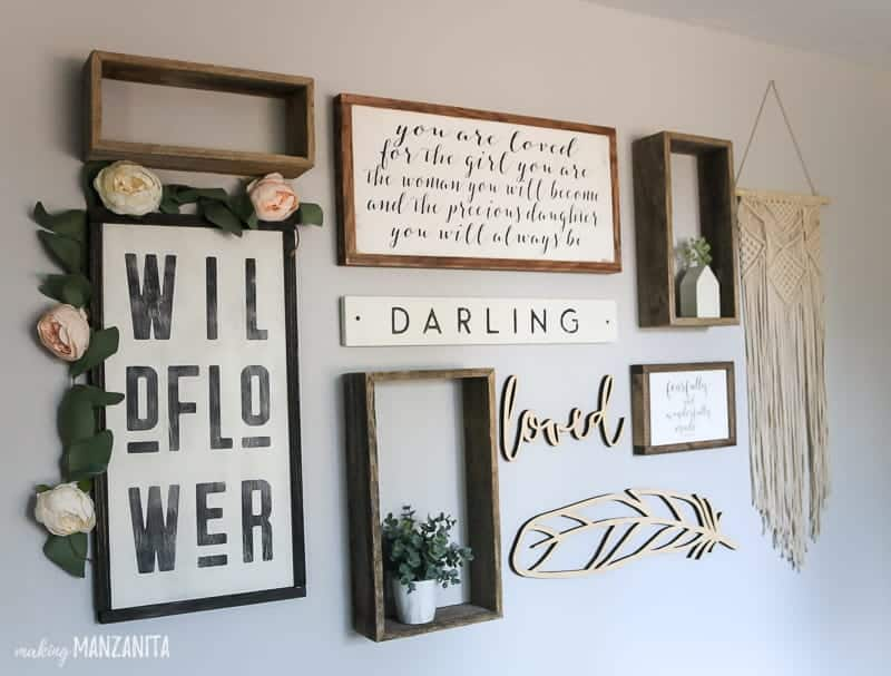 Rustic boho gallery wall layout for baby girl nursery