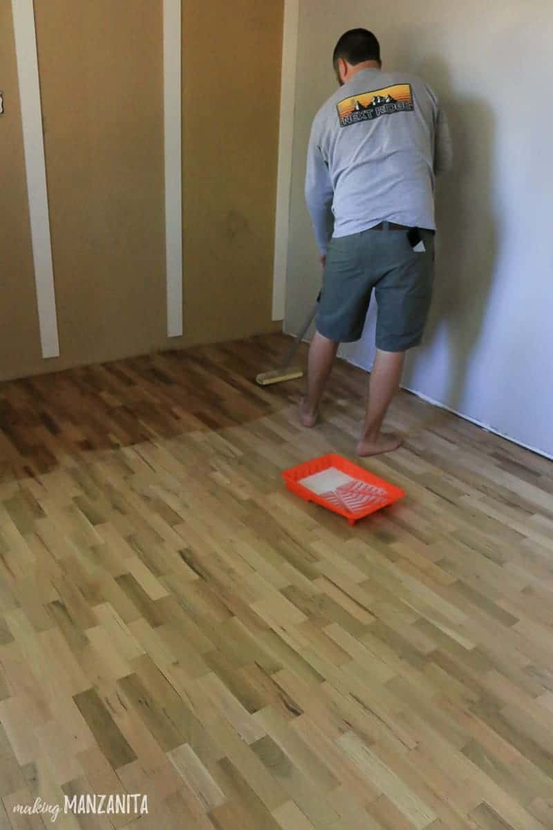 Man applying hardwood floor finish