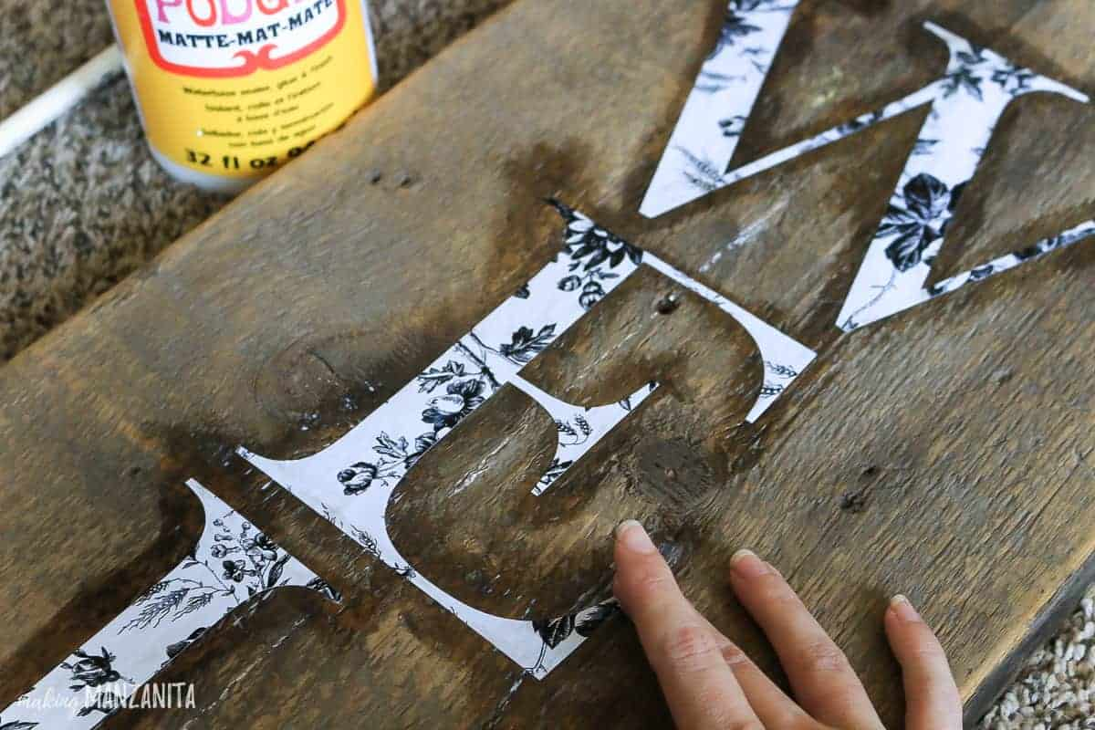 Sealing stencils with Mod Podge for crisp paint lines on wooden signs