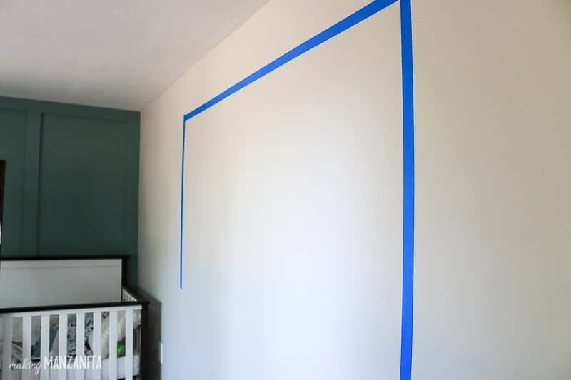 Tape boundaries of gallery wall before hanging wall decor